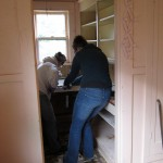03 Volunteers deconstruct the kitchen cabinets