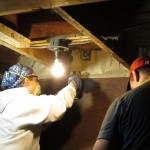 19 Volunteers installing insulation at the basement rim joists