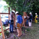 Tradeswomen build a new fence