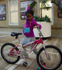 PCRI resident Hermela enthusiastically shows off her new bike