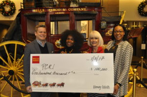 PCRI Executive Director Maxine Fitzpatrick (2nd from left) accepts a grant from local Wells Fargo executives, left to right: Andrew Tweedie, Community Affairs officer; Tracy Curtis, Regional President; and Cobi Lewis, Community Development officer. PCRI will use the $100,000 grant to build 22 affordable homes for sale to low-income buyers displaced from N/inner NE Portland