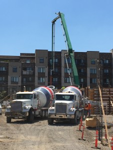 Trucks deliver concrete for the first walls at the Beatrice Morrow building
